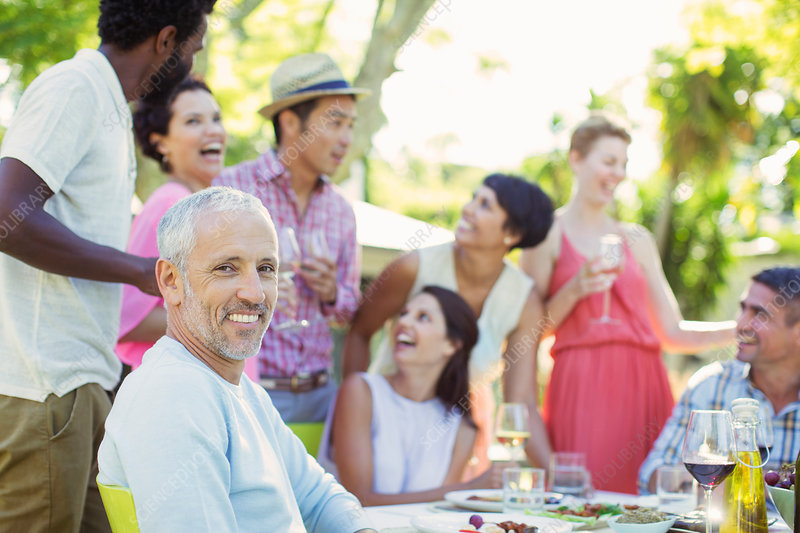 Man smiling at party outdoors