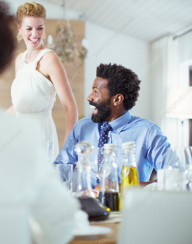 Man laughing at dinner party