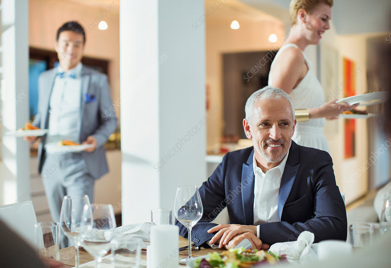Man sitting at table at dinner party