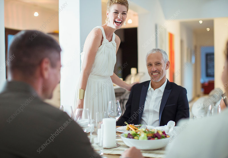 Couple laughing at dinner party