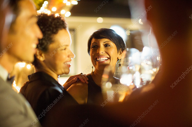 Women laughing at party