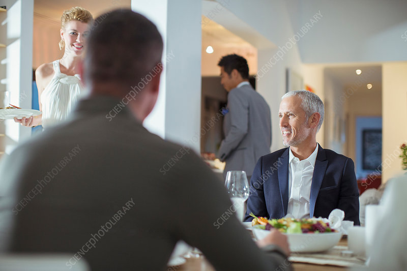 Man smiling at table at dinner party