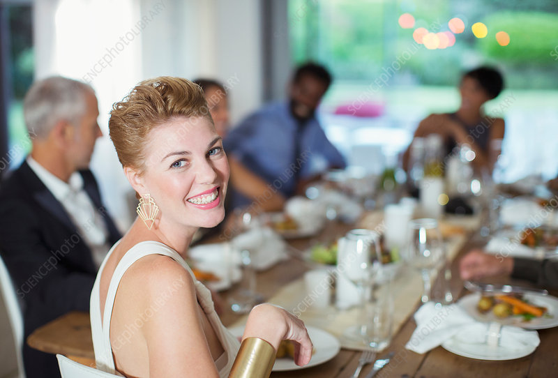 Woman smiling at dinner party