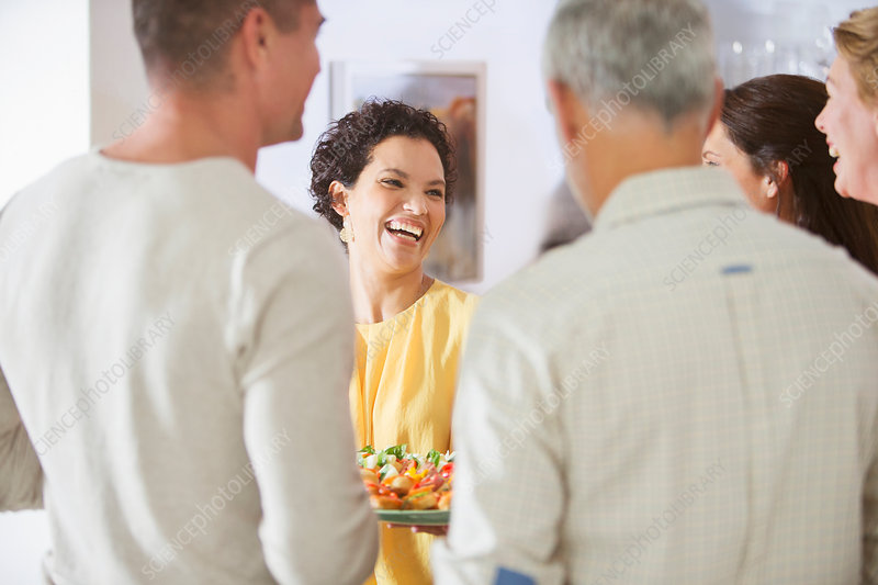 Woman laughing at party