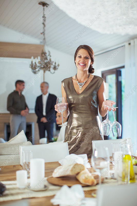Woman setting table at dinner party