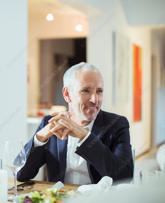 Man sitting at dinner party