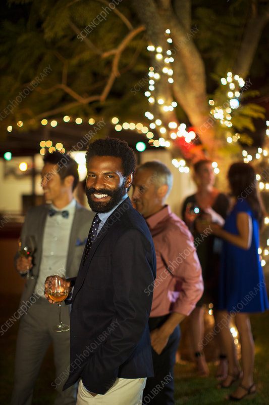 Man laughing at party