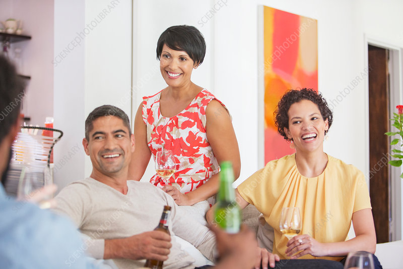Friends relaxing together at party