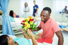 Man giving girlfriend bouquet of flowers