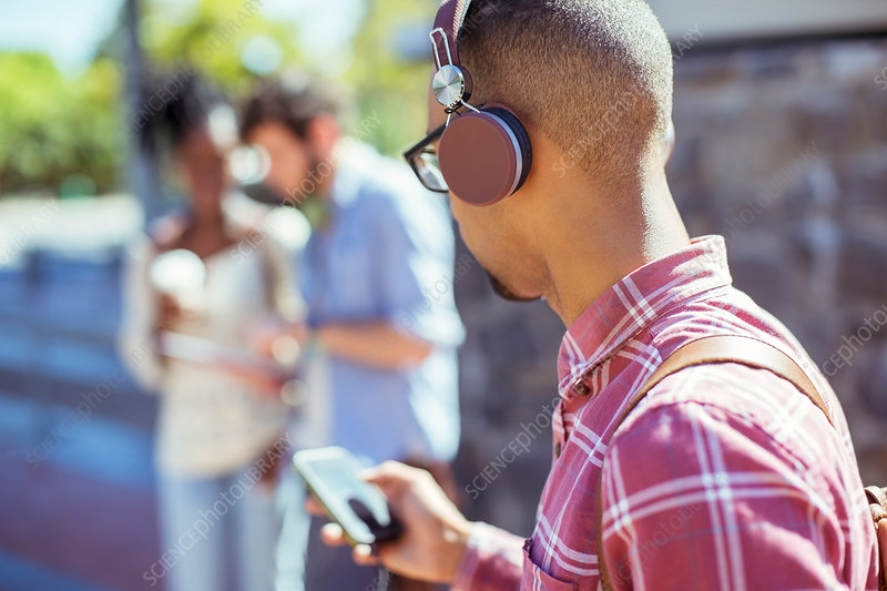 Man listening to mp3 player outdoors