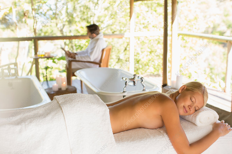 Woman laying on massage table in spa