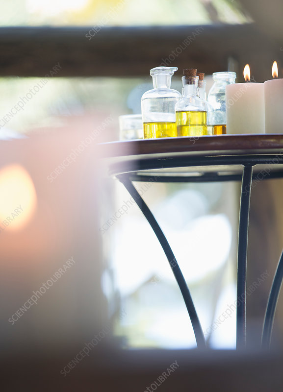 Essential oils and candles on table