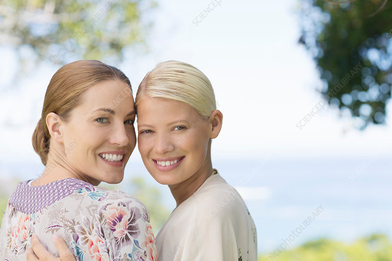 Smiling women hugging indoors