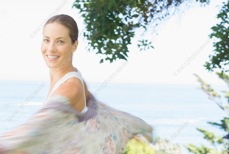 Blurred view of woman spinning outdoors