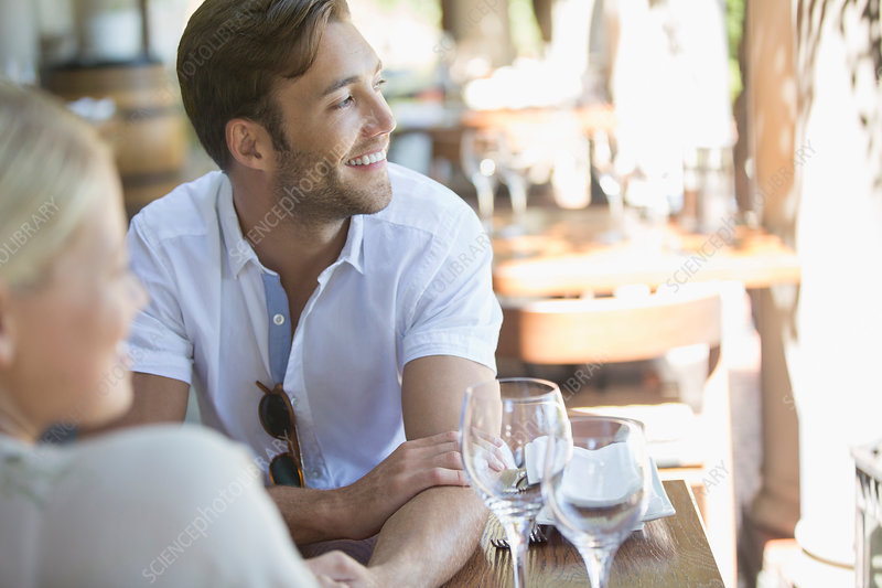 Couple sitting together in restaurant