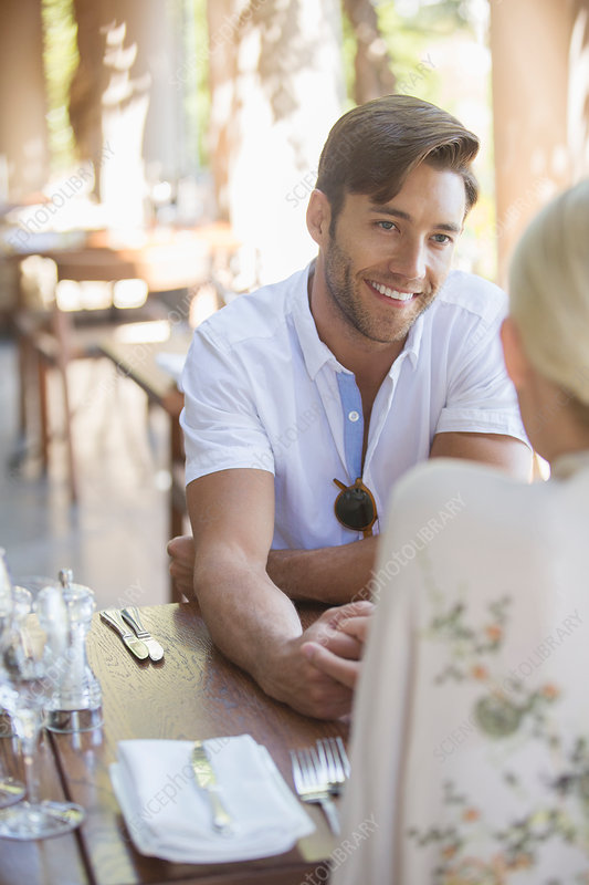 Couple talking in restaurant
