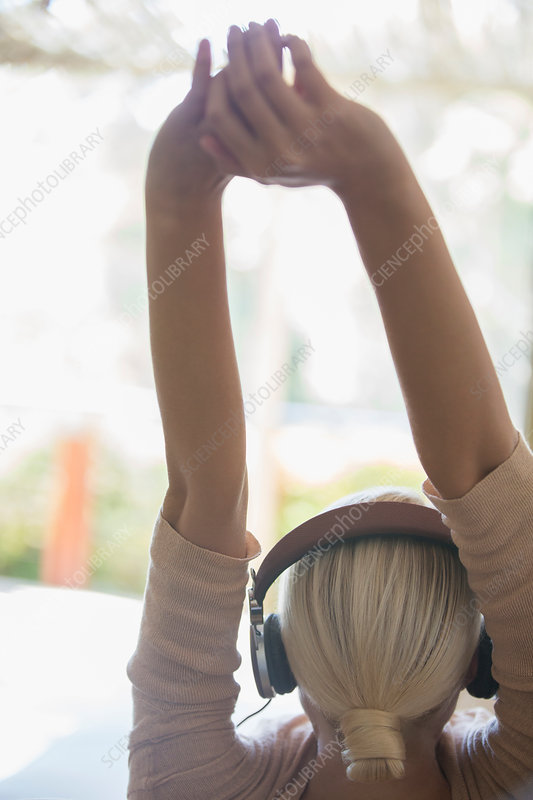 Woman stretching in headphones