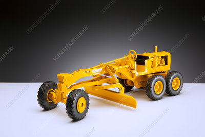 Model of road grader on pedestal