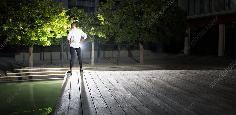 Man standing in park at night