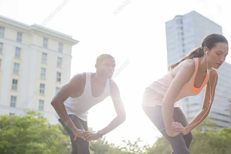 Couple stretching before exercising