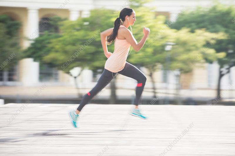 Woman running through city streets