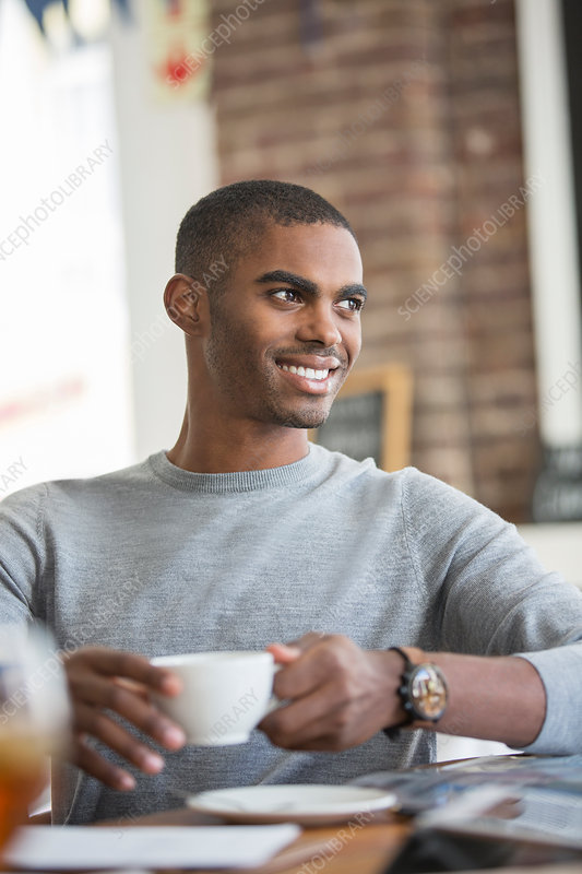 Man having coffee in cafe