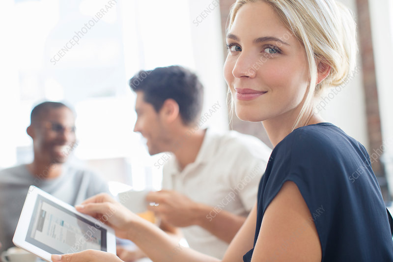 Businesswoman using tablet at meeting