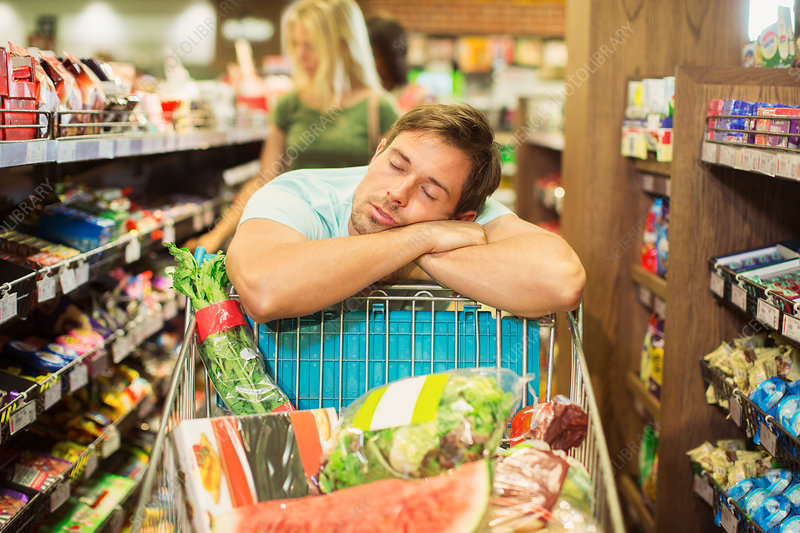Man sleeping on shopping cart