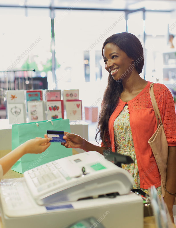 Woman paying with credit card