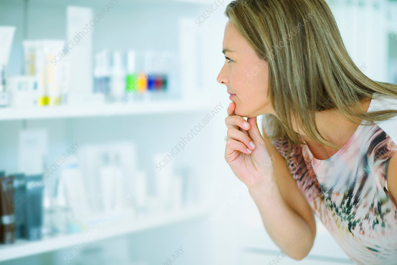 Woman examining skincare products