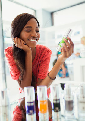 Woman examining skincare product