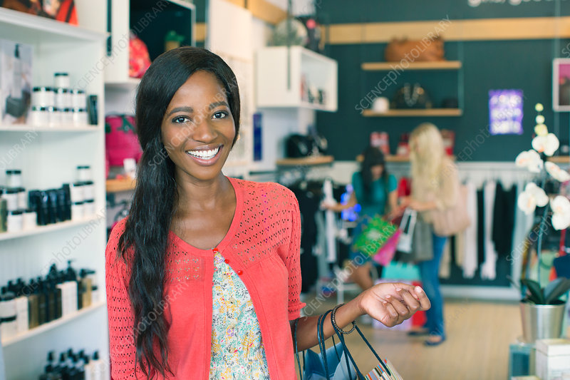 Woman smiling in clothing store
