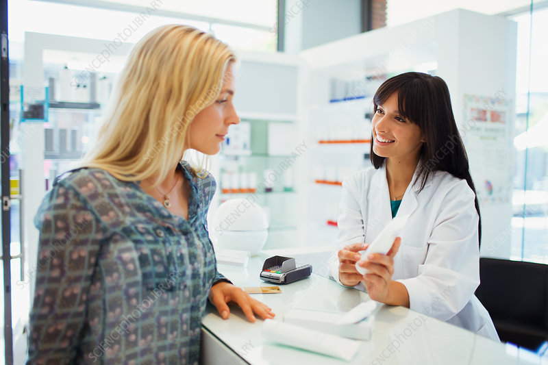 Woman discussing product with pharmacist
