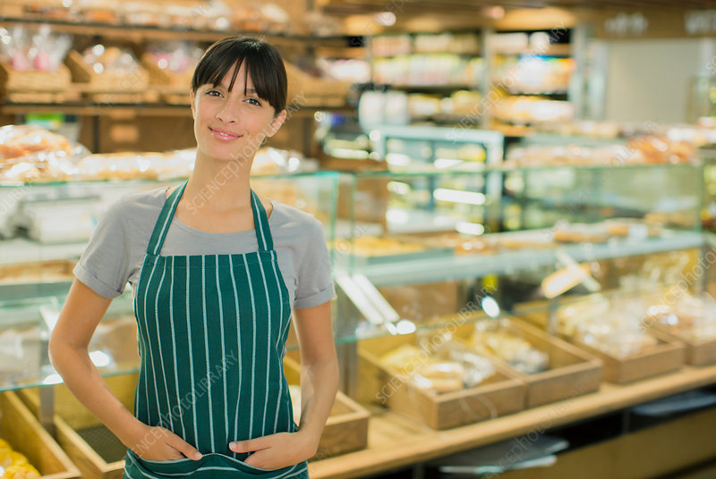 Clerk smiling in grocery store