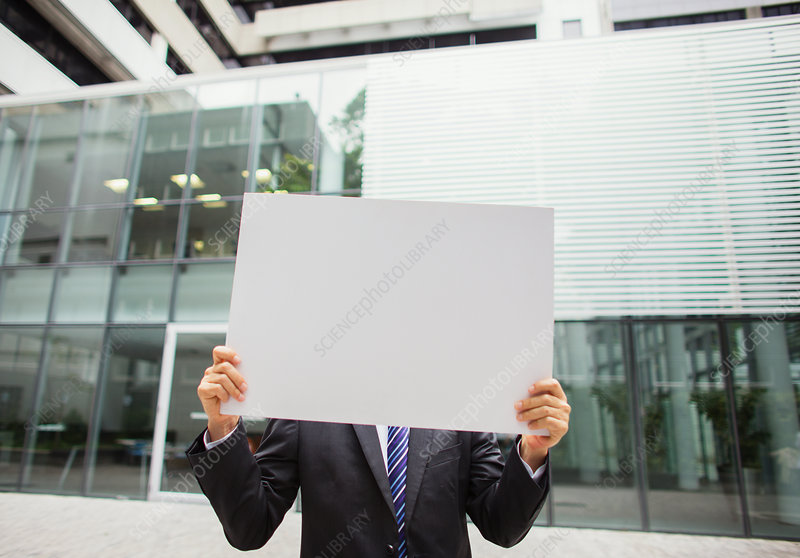 Businessman holding document