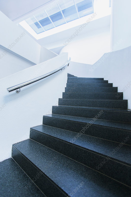 Black and white winding staircase curving