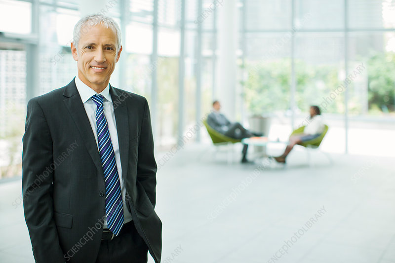 Businessman smiling in office building