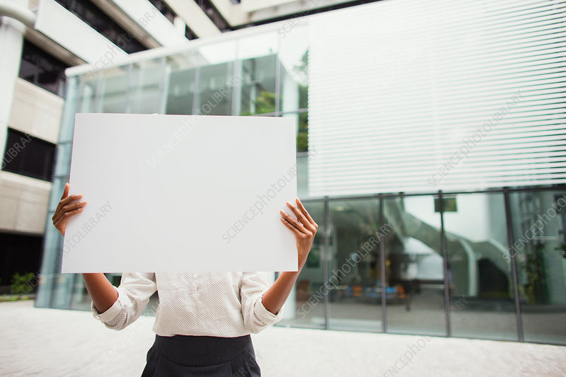 Businesswoman holding cardboard