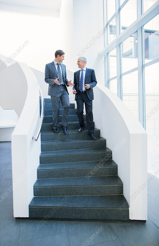 Businessmen talking on stairs