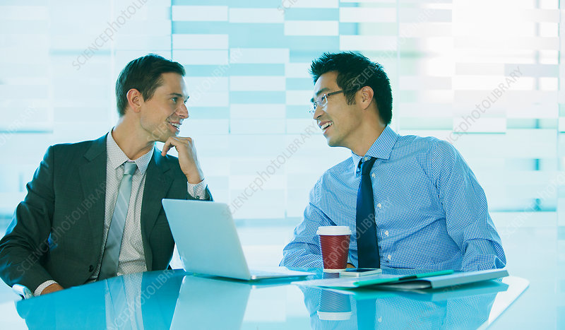 Businessmen talking at table