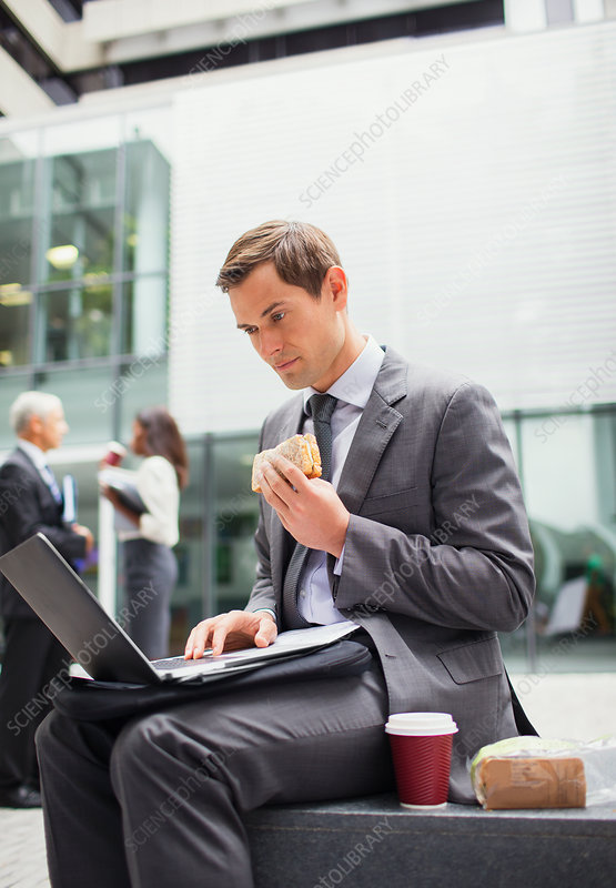 Businessman eat lunch and working