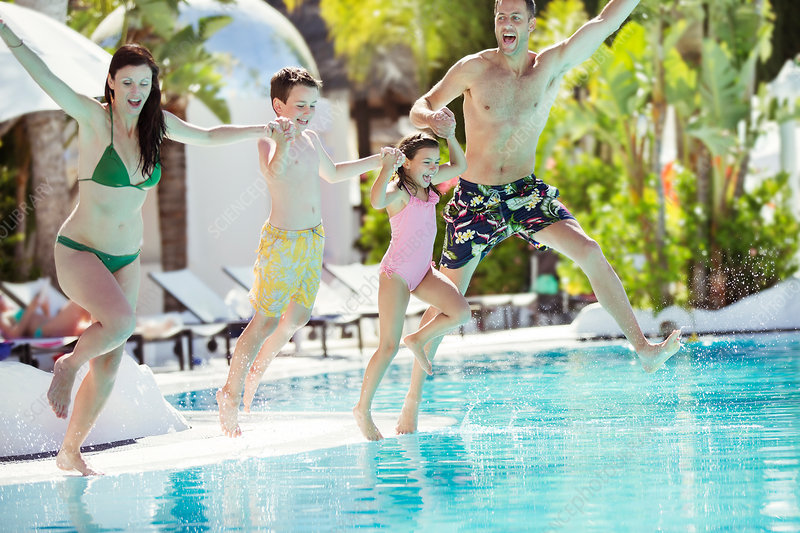 Parents with son and daughter jumping