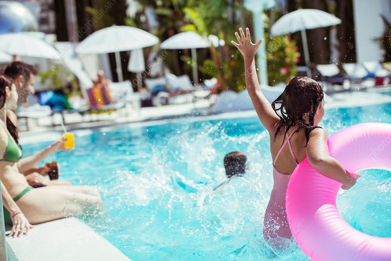 Girl with pink inflatable ring