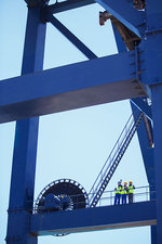 Workers standing on crane