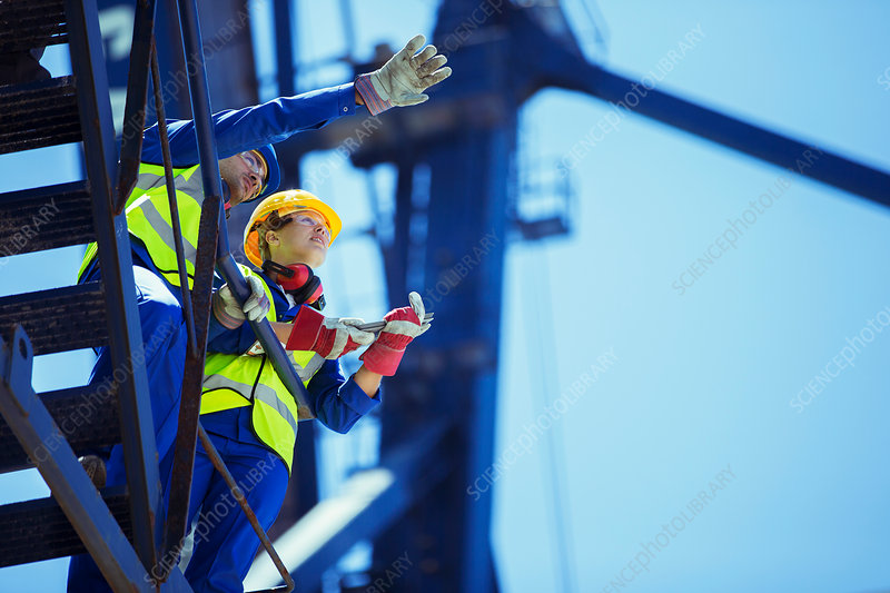 Workers talking on crane