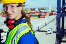 Worker smiling near cargo containers