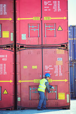 Worker opening cargo container