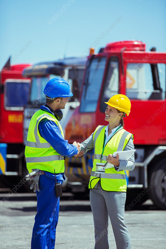 Businesswoman and worker shaking hands