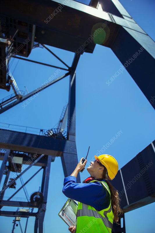 Worker using walkie-talkie