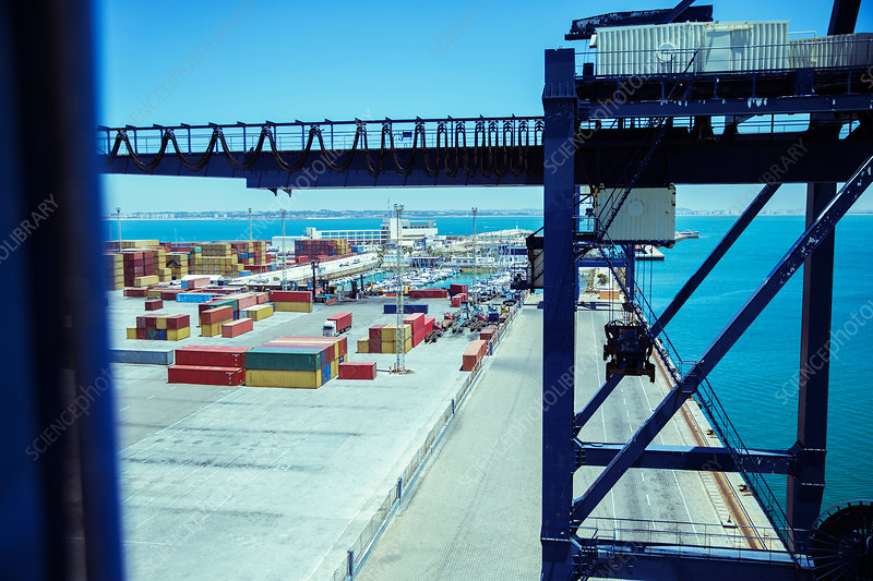 Crane and cargo containers at waterfront